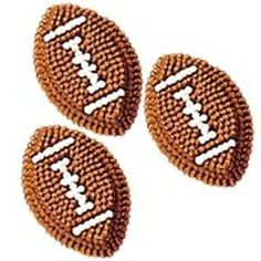 These football decorations are perfect additions to a themed cake.