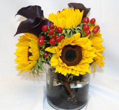 Long lasting arrangement of sunflowers, mini calla lilies and berries! #florist #flowershop #flowers #florals #flowerarrangement #floralarrangement #sunflower #sunflowers #minicallalily #minicallalilies #callalily #flowerdesign #flowersoftheday #flowerlover #flowerlovers #flowerslovers #flowerpower #blooms #fall #fallflowers #flower