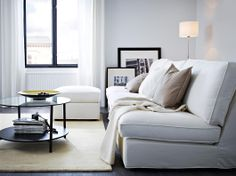 KIVIK three-seat sofa combination and footstool with Blekinge white cover and VITTSJÖ black-brown coffee table with glass top panel