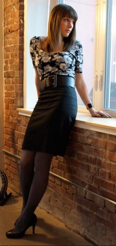 Floral tucked in blouse with a belted high waist skirt