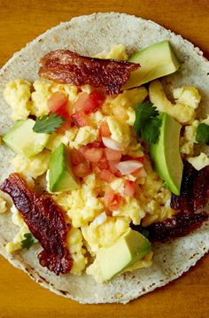 Easy breakfast taco recipes. This one is full of bacon and avocado. Get the recipe: http://blog.freshdirect.com/breakfast-taco-recipes/