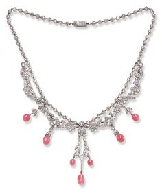 AN EXQUISITE BELLE EPOQUE CONCH PEARL AND DIAMOND NECKLACE Of garland motif, the floral swags suspending conch pearl drops, from a rose-cut diamond back chain, mounted in platinum, circa 1910, 15½ ins.