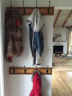 Lauren Liess | Pure Style Home - double rows of hooks in the entryway for coats