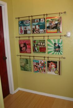 Cute idea - hang scrapbook pages. Would be fun to do in the baby's room with pictures of all the family members.