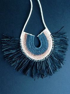 Black woven rope necklace with raffia fringe