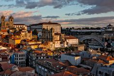 36 Hours in Porto, Portugal - via The New York Times 28.01.2016 | From its stunning Beaux-Arts station to its cool bars serving Porto's signature drink, this charming city combines the best of old and new. Photo: Porto at sunset, with the cathedral at left and the Dom Luís I bridge at right.