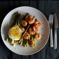 Garlic sautéed shrimp over asparagus.