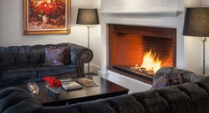 Camden Harbour Inn. Camden, ME. The fireplace beckons in the hotel's common area