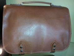 Florence Shop Collection medium size  Briefcase $420 ...To order please call (210)497-4000