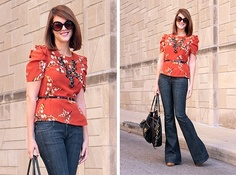 orange top, cute sleeves, dark denim, and bubble necklace.