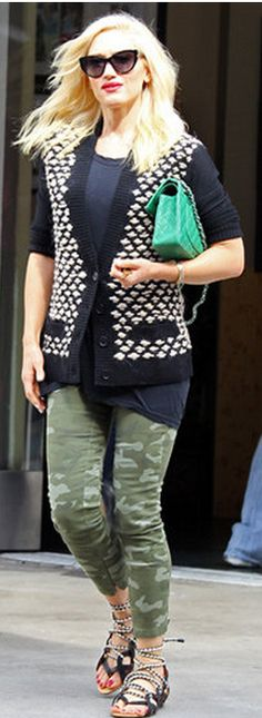 Who made Gwen Stefani's green quilted handbag, print cardigan sweater, black cat sunglasses, and flat lace up sandals? Sunglasses – Christian Dior  Sweater – Kelly Wearstler  Shoes – L.A.M.B.  Purse – Chanel  Shopbop