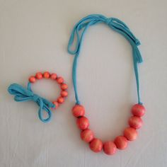 Wood Bead Necklace/Bracelet Set Coral and Aqua by easilycharming  #mommynecklace #nursingnecklace #nursingbracelet #teethingnecklace #teethingbracelet #organic #natural #woodbeads #knitcording #tugpullplay #comfy