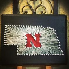 Visit my Etsy page if you would like to order one at: https://www.etsy.com/shop/MarrissasStringArt Or visit my How To Blog: http://marrissas.blogspot.com/  Another one done! Fun doing another state other than Iowa! :) Nebraska, state string art, string art, Corn Huskers, football