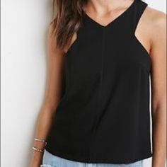 Black cross Neck Forever 21 Top Never worn. Slit in back (see picture) Forever 21 Tops Tank Tops