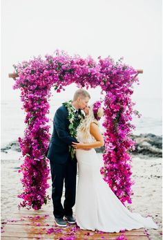Our wedding arch we were married under with tons of fuschia orchids & bouganvilla
