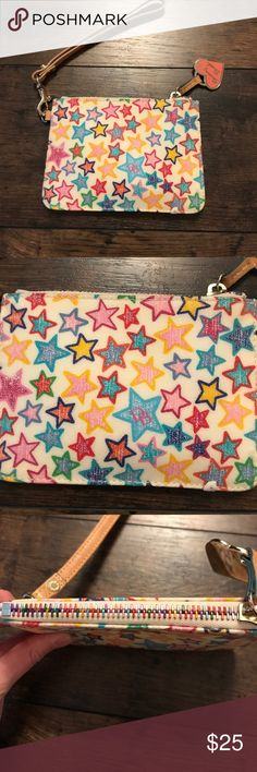 """Dooney & Bourke Wristlet Excellent condition Dooney & Bourke wristlet. Coated canvas material in a fun rainbow star pattern. Features tan wrist strap, pink D&B heart logo and rainbow zip closure. Also has a key ring located inside. 5.75"""" wide x 4.25 """" high. Sorry no trades! Dooney & Bourke Bags Clutches & Wristlets"""
