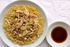 Cantonese Fried Noodles (Pork Chow Mein) Recipe Main Dishes with egg noodles, pork, black mushrooms, beansprouts, yellow chives, ginger, salt, marinade, salt, soy sauce, ground white pepper, wine, corn starch, oil, oyster sauce, sugar, soy sauce, corn starch, water
