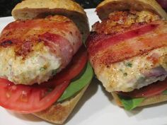 """BACON-WRAPPED CHICKEN SLIDERS ~ I recently picked up """"The Burger"""" cookbook (published by Love Food) at my local Barnes & Noble and was so inspired by the recipes I decided to treat my guys to a version of one of their burgers every other night for the next 10 nights. With a bit of adaptation, I turned their """"Bacon-Wrapped Chicken Burgers"""" (featuring pine nuts–yes!) into lovely little sliders. And my guys? Thrilled–and oh-so-filled!"""