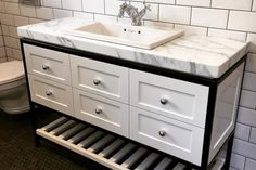 Browse our beautiful bathroom designs for inspiration.The client has skilfully blended classical and contemporary elements to create a home which feels spacious and timeless. White Bathroom Designs, Black White Bathrooms, Bathroom Vanity, Home, Beautiful Bathrooms, Spacious, Kitchens Bathrooms, White Bathroom, White
