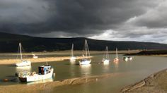 The sun was breaking through the dramatic storm clouds to illuminate the yachts on the estuary at Barmouth, Gwynedd. Picture taken by Mark Weston from Hengoed, Caerphilly. Snowdonia National Park, Storm Clouds, Yachts, Small Towns, Wales, National Parks, Scenery, Places To Visit, Castle