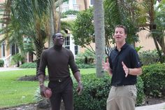 Two A-Players addressing the group: Michael Irvin and JT Foxx.