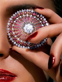 Eye Candy - BEAUTY BAZAAR: Essie Nail Color in Leading Lady is the ultimate glittering red for fall ($9). Buccellati brooch, $89,000, 212-308-2900. KENNETH WILLARDT