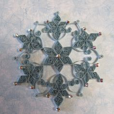 Quilled Snowflake Ornament by HeirloomQuilling on Etsy https://www.etsy.com/listing/205276694/quilled-snowflake-ornament