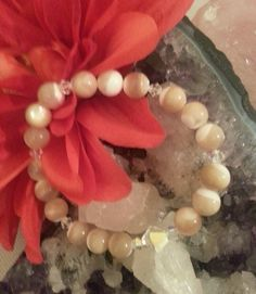 Mother of Pearl Bracelet with Swarovski Crystals – Evolve Jewelry Design www.evolvejewelrydesign.net www.facebook.com/evolvejewelrydesign1