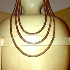 Vintage gold triple graduated necklace This piece is over 15 years old. It was my grandma's and she kept it in pristine condition. I just cleaned it this morning. The shortest part of the necklace is approx. 16 and 3/4 in. Long. Photo 2 gives you an idea of how it is attached. The other two graduate down in length. An awesome piece to layer with by itself or add a beautiful choker to complete an amazing look. Jewelry Necklaces