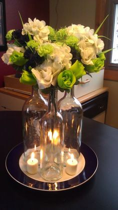 BOTTLE CENTERPIECE AND CANDLES