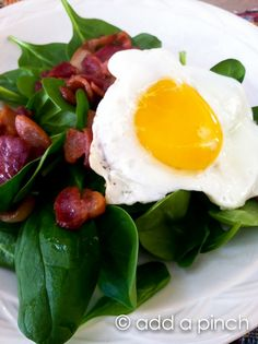 Breakfast Salad.  Bacon and eggs over a bed of spinach. Healthy and high protein. This would be a simple and healthy dinner too.