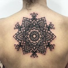 Ornamental style mandala tattoo on the upper back. By Melow Perez.