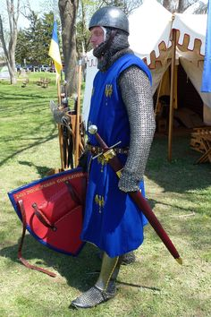 Cervalliere helm, sword, scabbard, and heater shield circa 1300