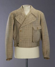 A well worn men's jacket from the Great Depression.  Double breasted form without the 2nd set of buttons.  Nice pocket detail.