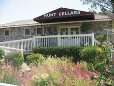 Hunt Cellars tasting room is a refurbished farmhouse with a wraparound veranda overlooking a lovely lawn that looks perfect for a blanket and picnic basket!
