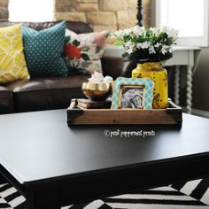 Trays on the coffee table are a great place to display a few pretty things and to collect remotes so they don't get lost!  Tray, candle holder turned vase, and frame are all #homegoods finds.  #homegoodshappy #sponsored #happybydesign