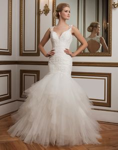 Justin Alexander wedding dresses style 8827 This beaded Chantilly lace mermaid gown featuring a deep V-neckline, lace straps, a tulle handkerchief skirt and a deep keyhole back evokes a feeling of sophisticated drama.