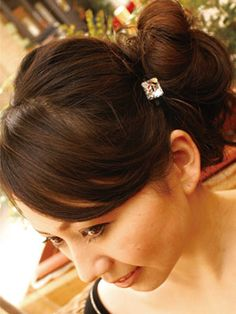 messy bun using a hair pin with dazzling crystal stone