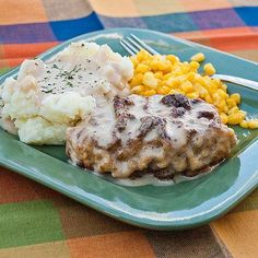 Easy Baked Pork Chops- The breading on these pork chops is crispy, but baking them in an easy sauce makes them creamy as well. Try this recipe for an easy weeknight dinner!