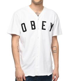 "Play for the winning team with the Charlie baseball jersey from Obey. An all white, 100% cotton jersey features black felt stitched ""OBEY"" letters on the chest, full button up placket with pearl buttons and finished off with a rounded, surged bo"