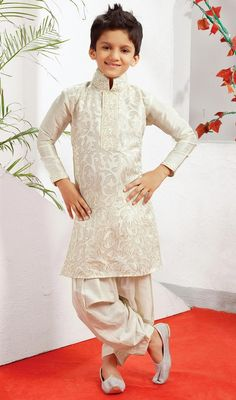 Off white poly dupion silk indowestern suit designed with resham and patch border work. Available with off white poly dupion patiala. #BoysKurtaSalwarCollection