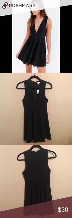 Plunge deep V black dress, textured, Lucca Couture Fun, sexy black dress! Never been worn. Bought it for my honeymoon and ended up not wearing it. Fits true to size but also has a little stretch to make it very comfortable! Lucca Couture Dresses Mini