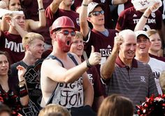 R.C. Slocum, right, former Texas A&M football coach, right, joins fans as they cheer on the set of EPSN's College Gameday before an NCAA college football game between Alabama and Texas A&M. (David J. Phillip/AP)