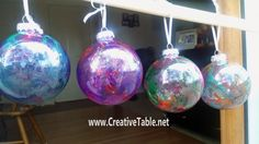 Make Colorful Ornaments with Unicorn SPiT~~Used:~clear glass ornaments ~Mod Podge ~Unicorn SPiT paint & MinWax Spar Urethane  (sealer)~~