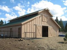 We offer custom horse barn kits in a variety of designs. Contact Hansen Pole Buildings about horse barns. Pole Barn House Kits, Diy Pole Barn, Building A Pole Barn, Pole Barn House Plans, Barn Garage, Pole Barn Homes, Pole Barns, Barn Houses, Garage Plans
