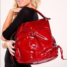 Francesco Biasia Dana Shoulder Bag beautiful candy apple red patent leather. Tote showcases leather ties at the bottom corners and edges of handles, stitch accent along handle, zip top closure, fabric lining. Inside zip pocket, two patch pockets. Francesco Biasia Bags Shoulder Bags
