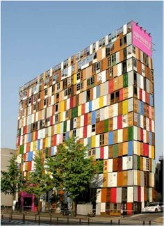 Yes, this building is way to colorful even for me... yet it is artistic... Building facade made of recycled doors