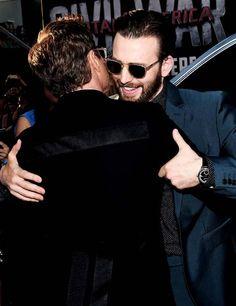 "Robert Downey Jr. (Iron Man/Tony Stark) and Chris Evans (Captain America/Steve Rogers) embrace at the premiere of ""Captain America: Ciivil War"""