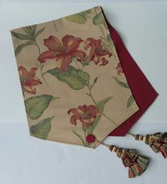 Elegant table runner is made from a red floral decorator fabric and has a red moire satin lining and button/tassel detailing. The size of the table runner is 62 in x 15 in. Table Runner And Placemats, Burlap Table Runners, Sewing Hacks, Sewing Projects, Diy And Crafts, Arts And Crafts, Table Set Up, Bed Runner, Printed Bags