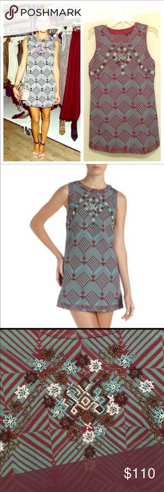 FREE PEOPLE Modsquad Ethnic Mini Dress - Crimson Colorful beadwork details the bodice of this sturdy shift dress, woven with a crisp geometric pattern. Buttons fasten the back placket from the collar to the hem. Unlined. Fabric: Geometric weave. 54% cotton/46% polyester. Free People Dresses Mini